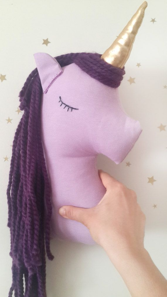 Unicorn pillow will bring a little magic to your kids rooms.  This beautiful unicorn has a shiny gold horn and purple mane made of very soft wool yarn. The eyes are hand embroidered.  Measures about 15,5 inches (39 cm) high.  This is a decorative item and ready to ship.   Thanks xX say hi on instagram to me @missjoyka Arma