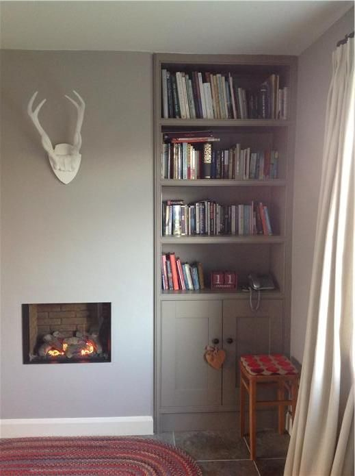 AChimney breast and hand built cupboard and shelves , walls in dove tale estate emulsion, woodwork in slipper satin and shelves in charleston gray.  n inspirational image from Farrow and Ball