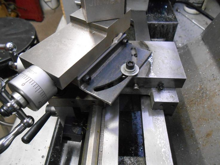 A Better Approach to Adjusting Compound Angles on Mini Lathe by bobs409 - One of the most annoying things about some small lathes is how you adjust the compound angles.  You have to back off the compound slide to reveal 2 cap bolts, loosen them, change your setting and tighten them.  Then crank the compound all the way back in.  Not the right setting