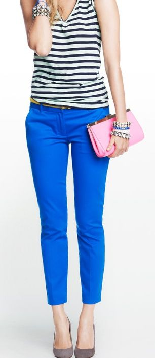 Striped top, bright blue trousers, neutral heels.