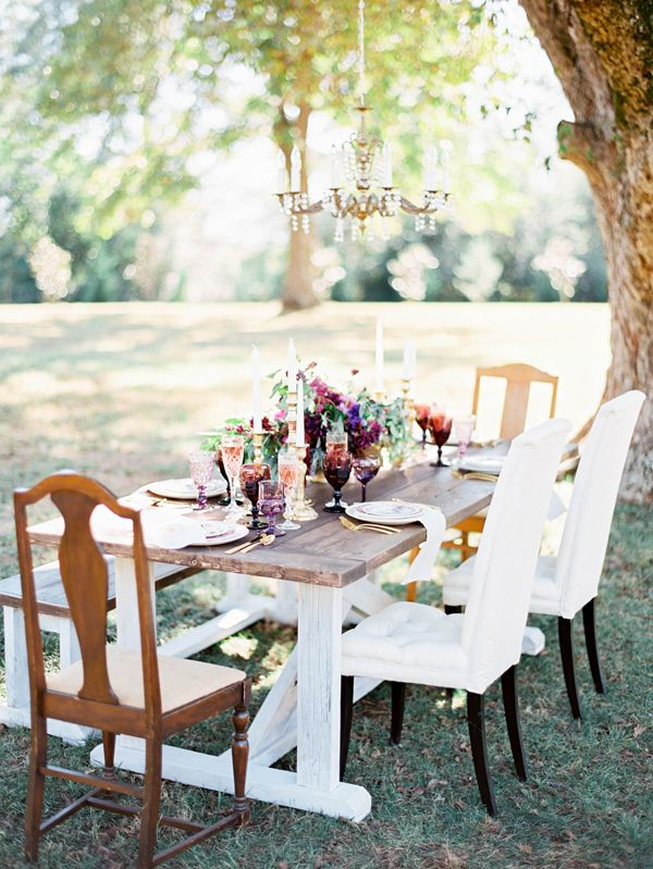 reception under the trees, photo by Ashley Slater Photography http://ruffledblog.com/a-southern-winter-wedding-with-jewel-tones #receptions #weddingtable