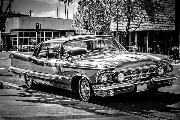 Detailed black and white photo of a 1957 Chrysler Imperial park on a Stockton, California street.