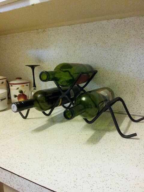 Triangular, metal wine rack!  A sleek and stylish way to display your fine wines!