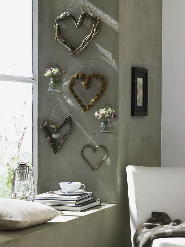 A Collection Of Driftwood Hearts As Wall Decor