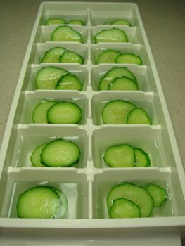 Cucumber ice cubes... a great way to use up the extras I always inevitably buy... these are my favorite in plain water
