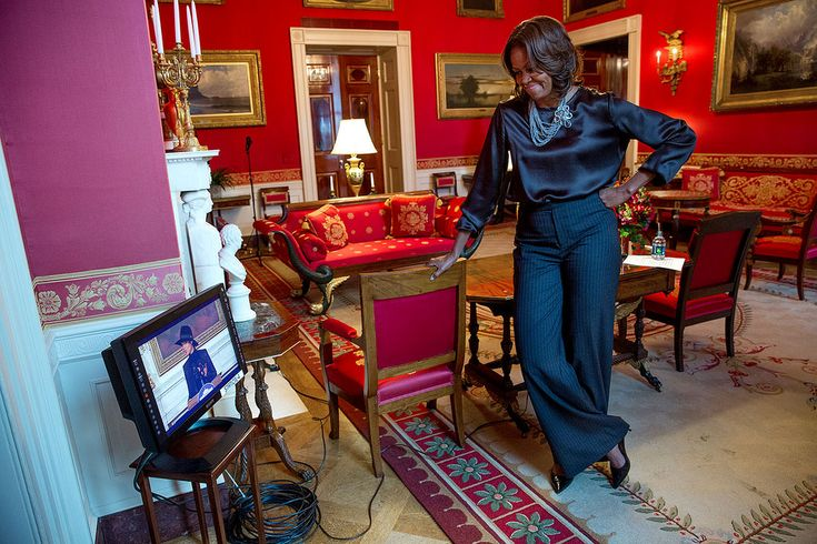 """First Lady Michelle Obama watches from the Red Room as Alicia Keys delivers remarks prior to a screening of """"The Inevitable Defeat of Mister and Pete"""" in the State Dining Room of the White House, Jan. 15, 2014"""