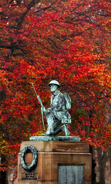 Autumn colours provide a dramatic backdrop to the war memorial in Shildon, County Durham.