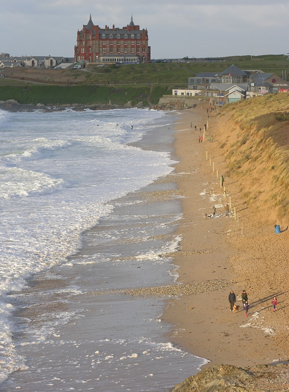 The Headland Hotel and Fistral beach at high tide.