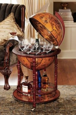 This globe bar has an added tray on the bottom for extra liquor or glasses, alongside wheels for easy movement.