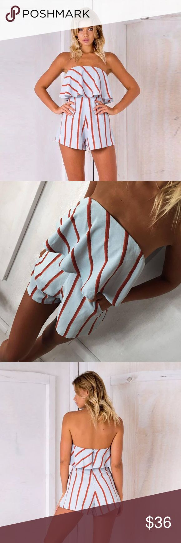 """Minty Color Changing Romper This adorable stripped playsuit may look like a light blue with red stripes or white with red stripes depending on the lighting, hence the title """"color changing"""".                                                                                Material content: polyester & cotton.                                    •2 side pockets and a zipper back• Dresses"""