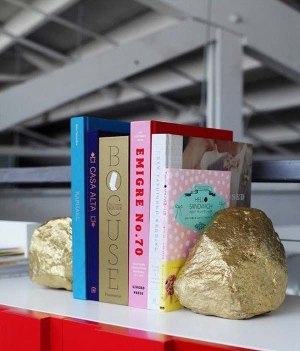 Make these cute book ends by spray painting rocks gold. | 30 Low-Budget Makeovers You Could Do With Spray Paint