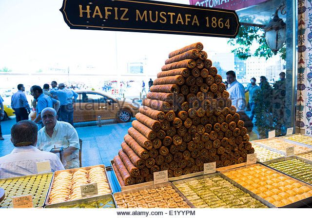 Traditional Turkish / Arabic sweets sold at the famous Hafiz Mustafa 1864 sweet shop by Taksim sq. in Istanbul. - Stock Image