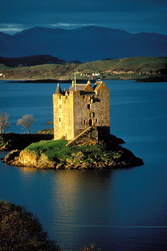 Castle Stalker, Loch Linnhe, Scotland - a four-story tower house or keep. The original castle was a small fort, built around 1320 by Clan MacDougall who were then Lords of Lorn.