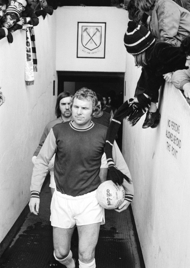 9th March 1974: English footballer Bobby Moore (1941 - 1993) leads the West Ham reserves onto the pitch before a match against Plymouth Argyle reserves at West Ham's Boleyn Ground. This was Moore's last match at the ground before his transfer to Fulham FC (Photo by David Ashdown/Keystone/Hulton Archive/Getty Images)