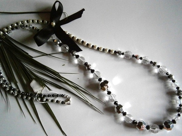 """40"""" BLACK ,CREAM, SILVER & CLEAR 'A 'SYMETRICAL BEADED NECKLACE WITH BOW DETAIL - Creative Connections"""