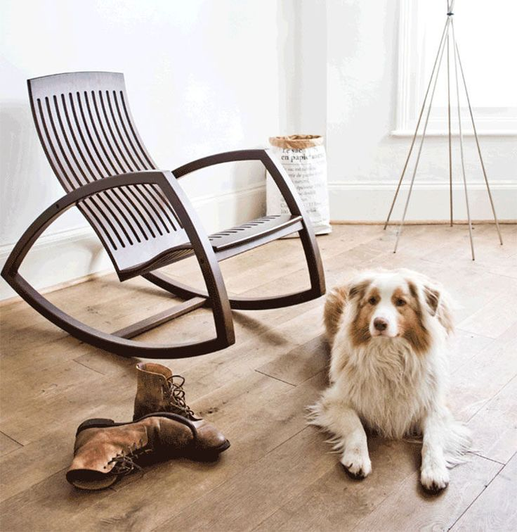 Furniture Ideas - 14 Awesome Modern Rocking Chair Designs // The open sides and floating seat of this rocking chair give it a more modern feel white the dark wood makes it warm and inviting.