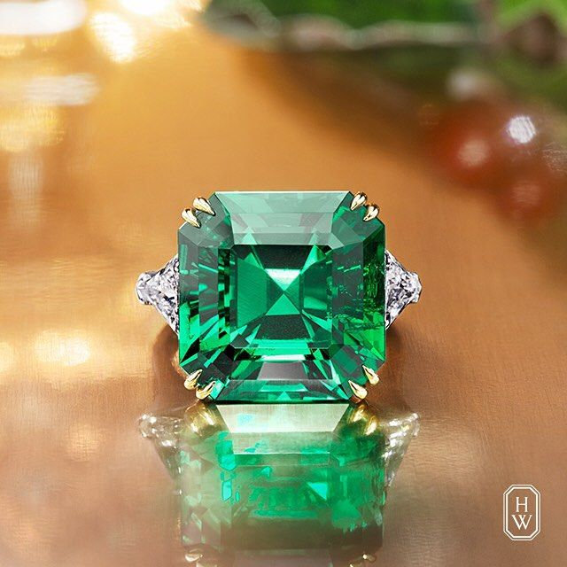 Extraordinary 16.13 carat Colombian Emerald Ring with diamond side stones. Harry Winston