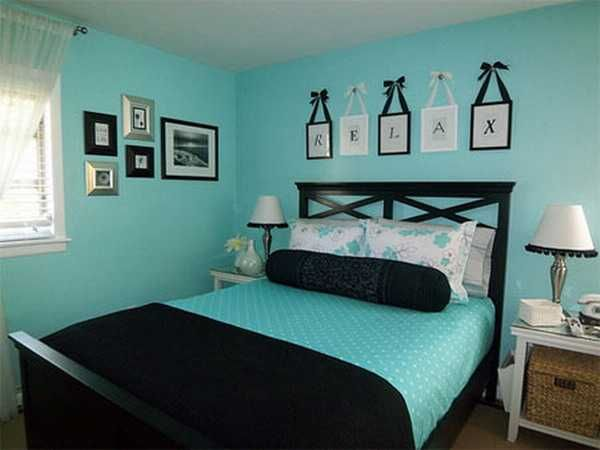 blue paint and bedding with black bedroom decorating