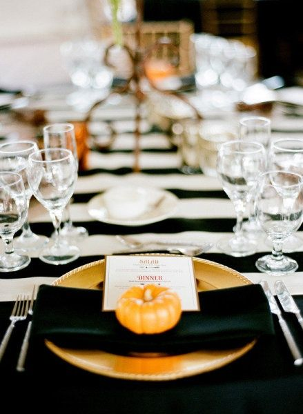 Beautiful black and white table with a pop of orange from the baby pumpkin.
