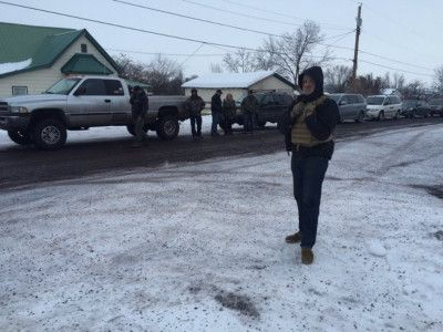 """Armed men with a group called the Pacific Patriots Network stationed themselves around the Harney County Courthouse Saturday afternoon.one of their members, Joseph Rice, told OPB the convoy went to the courthouse to deliver what he called their """"articles of resolution"""" to the county."""