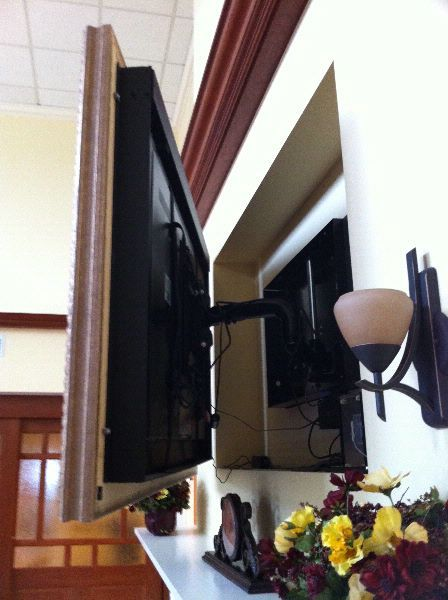 """Make a frame on hinges and put the tv in the wall...a giant frame for all the pictures that sit on the computer when the TV isn't """"on."""""""
