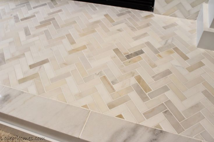Herringbone mosaic tiles (by Allen & Roth, available at Lowe's)