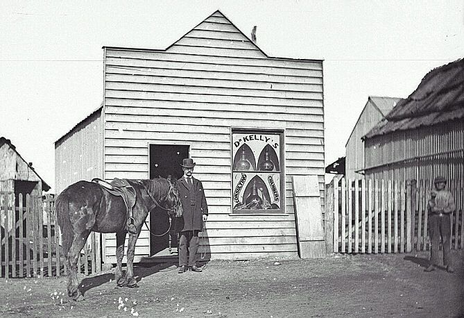 Dr Kelly of Gulgong in 1870. Surgery behind him, wheels in front.