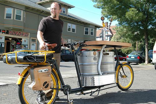 Phillip Ross of Metrofiets rolls out the new Hopworks party bike, complete with wood bar, kegs on tap, pizza rack, sound system, and mountains of mojo.