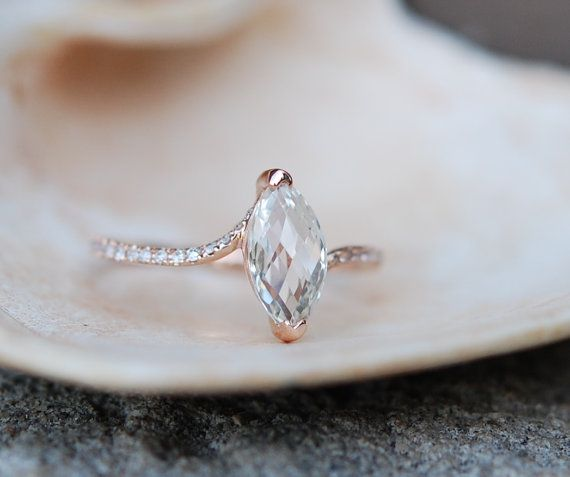 Rose gold diamond ring engagement ring with 1.5ct white marquise sapphire full eternity. Engagement rings by Eidelprecious.