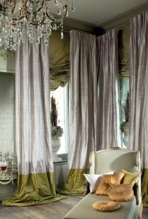 Silk Curtains are not just a back drop. They make a powerful and opulent statement in this space.