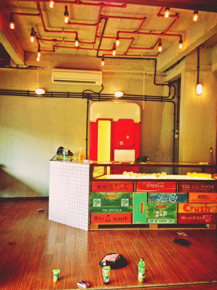 DIY soda crate white tile cashier table red pipe lamp and vintage vending machine mockup at 10dencies bintaro new store