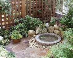 """Small garden with paving stones and water feature """"How To"""" Stylists Guide to Vintage & Antique Home Decor Project Pieces 