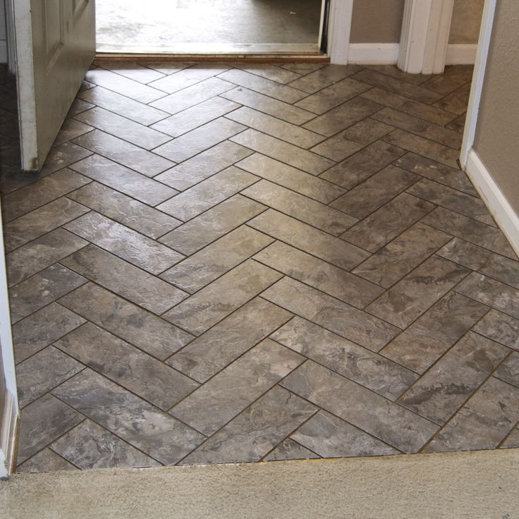 Herringbone Vinyl Tile Pattern via Grace + Gumption. Peel and stick tile with grout. Finally a great tutorial on how to get this look.