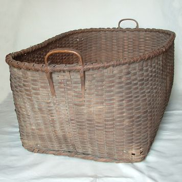 Woven splint basketFrom PA with wood handles. Measures 34 inches Length, 22 inches wide and 13 inches high (15 inches to handle). $ 600.00