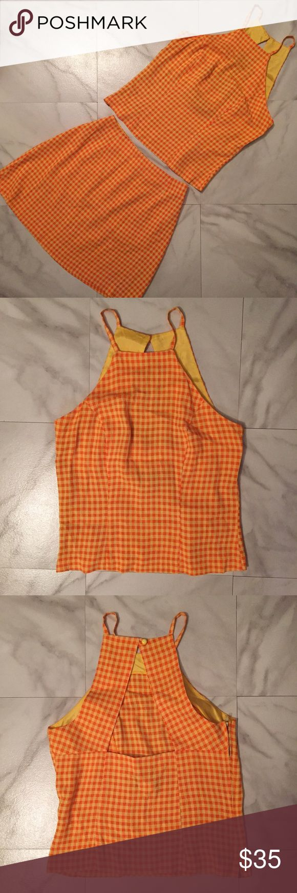 Adorable 90s Matching Orange Plaid Skirt Set! Amazing 90s orange and yellow gingham skirt and crop top set! Skirt and top both have zippers. The top is so adorable! It is higher neck, almost a halter style, then the back is open and has two panels that button together at the top! Is a juniors size 5, so it would fit a size 4-6! The waist measurement of the skirt is 25 inches! The length of the skirt is 16 inches! Please ask any questions and measure to ensure it will fit you! Vintage Skirts…