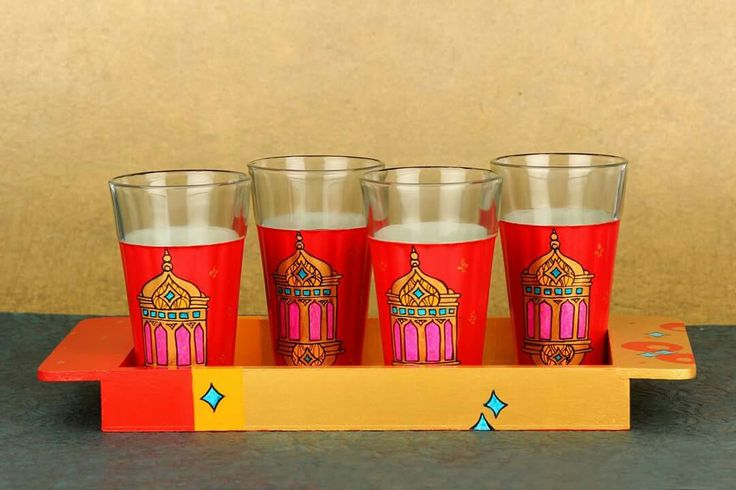 """Hand Painted wooden tray with a set of 4 hand painted glasses. Product name: """"Sharbat Glasses - Moroccan Lamp"""" #sharbat #makeinindia #glassware #artisans #Moroccan Know more - www.akrazymug. com"""