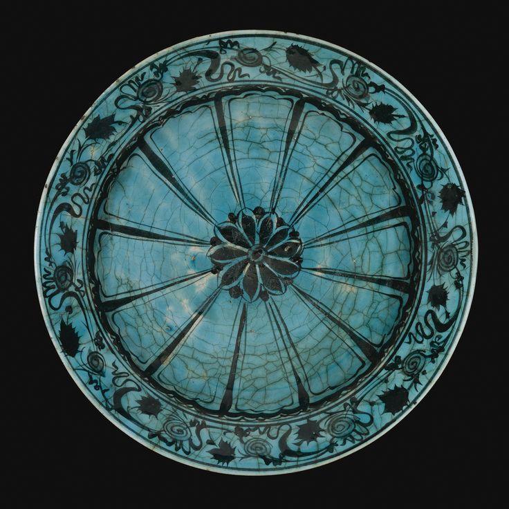 A TURQUOISE-GLAZED KUBACHI DISH, PERSIA, 16TH/17TH CENTURY