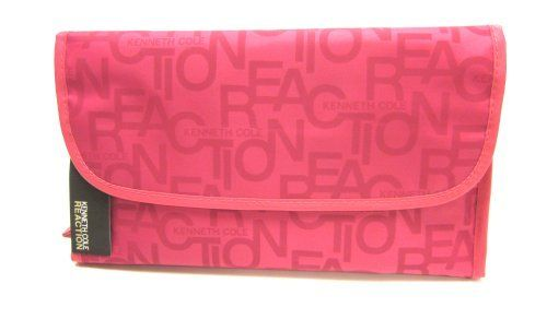 """Kenneth Cole Reaction Pink Folding Cosmetic Travel Case by Kenneth Cole REACTION. $24.99. This travel kit by Kenneth Cole Reaction neatly folds up when not in use and secures closed with magnetic snaps. When open, a metal hanger at the top allows the kit to hang on a door knob or hook for easy access to your belongings. Three separated zipper compartments in different sizes keep items stored neatly and securely. Measures 11"""" wide and 6.5"""" long when closed and 19"""" long when open."""