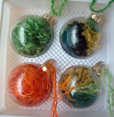Use scraps of yarn inside glass bulb ornaments. I love this trend of customizing plain glass ornaments, but I'm having the darnedest time finding unembellished glass ornaments this year.