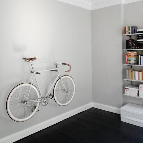 dark floors, white bookshelves, light colored walls