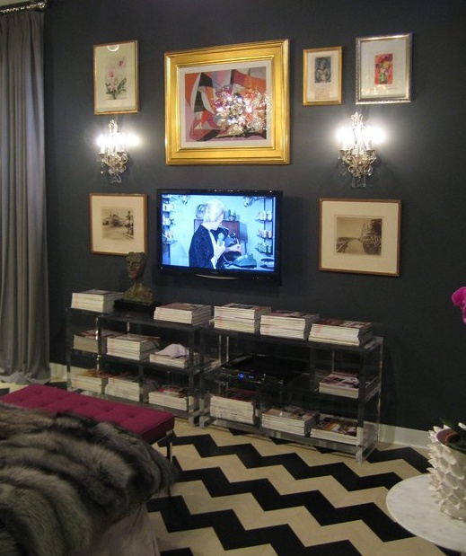 dark gray chevron bedroom by Anne Coyle. Great example of how styling a wall around a TV without necessarily making it the focus.