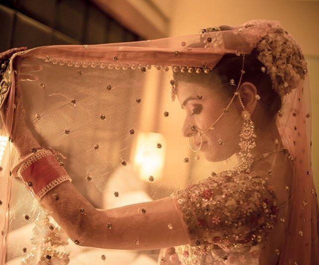 Sheer dupattas with gajra peeking through | pretty !!! Shot by @studiorgbindia | #bride #photography #sheer #gajra #dupatta #wedding #weddingday #bridalday #bridalportrait #hairstyle #bridalhair #instapic #fashion #instagood #igers #peach