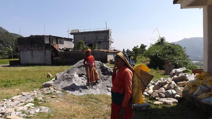 Moving small stones by hand, you seldom see machinery in Nepal.