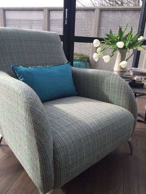 Tee chair from Lounge Design with metal legs