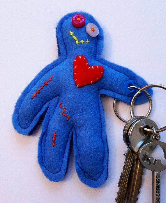Please note this item is on sale due to small imperfections. He is still fully functional and very loveable! Please ensure you read the listing fully as refunds will not be issued on sale items. This is a hand sewn felt keyring in the shape of a zombie. His name is Bobby and he enjoys holding keys or hanging out on bags. Dont worry, Bobby is now fully vegetarian so no brains are required. This item measures approximately 11 cm x 9cm. The little zombie has an appliqué heart, button eyes and…