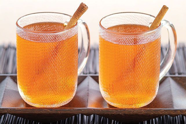 This hot brew, made from orange gelatin and apple juice and stirred with cinnamon sticks, is sure to warm up chilly ghosts and goblins.