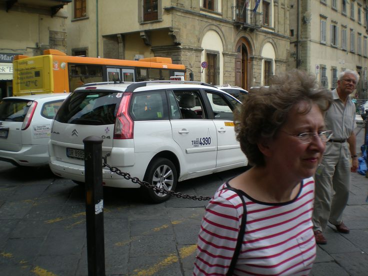 Cars and Renaissance buildings are a strange mix. Many electric cars in Florence plugged in to communal power outlets.