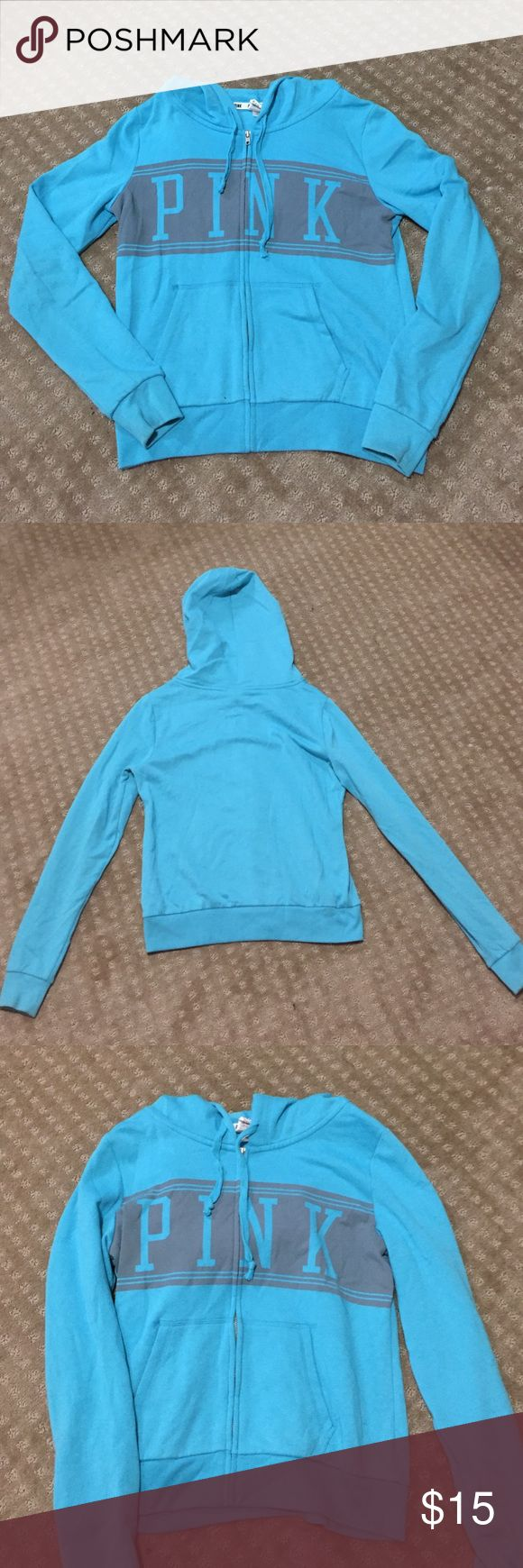 Blue Zip-Up Victoria Secret Pink Sweatshirt It's a light blue zip-up sweatshirt with the word pink across the chest! In great condition. No stains, holes, rips or tears. The zipper works too PINK Victoria's Secret Sweaters