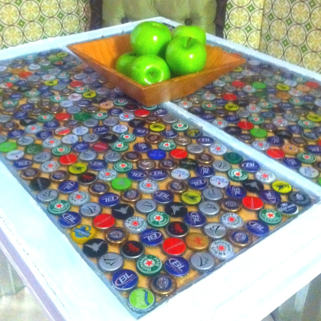 Bottle top table with poured epoxy set in an old window.