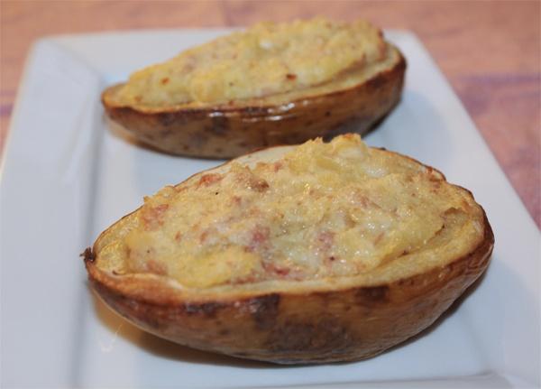 Patate al forno ripiene di prosciutto cotto, speck e formaggio